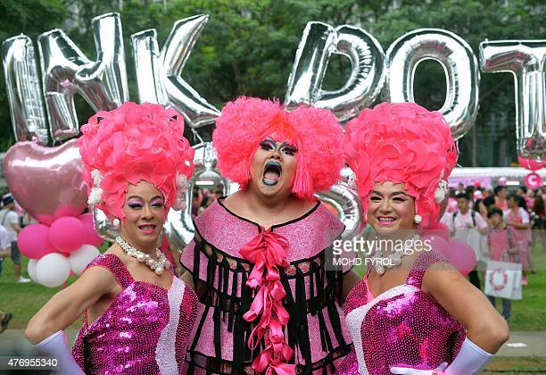 Participants dressed in pink pose for a photograph at the annual Pink Dot event in a public show of support for the LGBT community at Hong Lim Park...