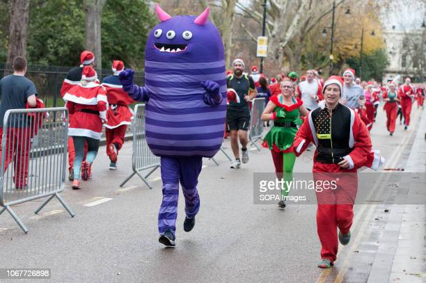 Participants dressed in Santa costumes seen taking part in run Runners dressed as Santa Claus participated in a large run in Victoria Park...