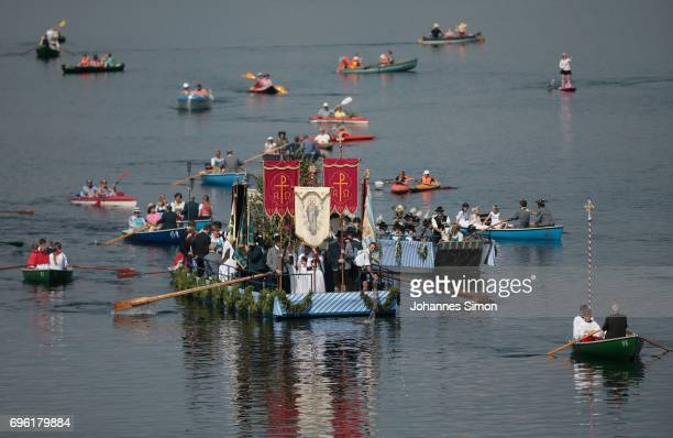 Participants dressed in traditional Bavarian folk outfits cross in boats the Staffelsee Lake in the annual Corpus Christi procession on June 15, 2017...