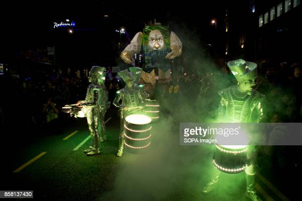 Participants dressed in white lighting costume are seen playing lighting drums during the Leeds Festival Light Night Leeds is an annual free...