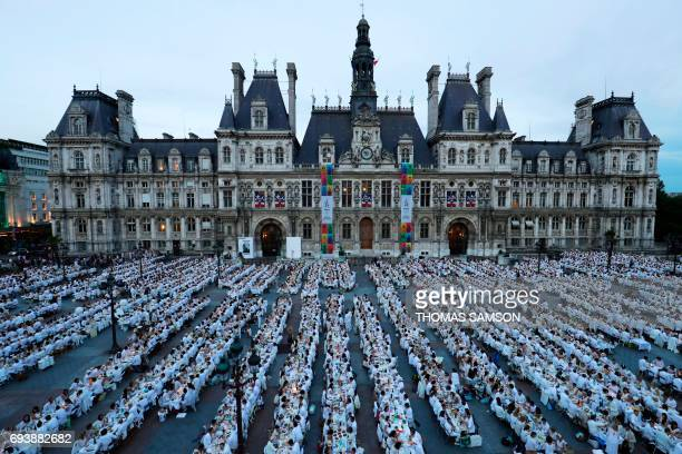 TOPSHOT Participants dressed in white participate in a Diner en Blanc in front of the City Hall in Paris on June 8 2017 The 29th Edition of the Diner...