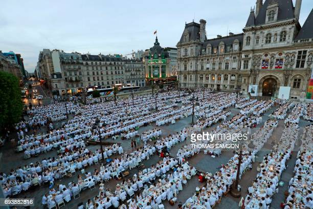 Participants dressed in white participate in a Diner en Blanc in front of the City Hall in Paris on June 8 2017 The 29th Edition of the Diner en...