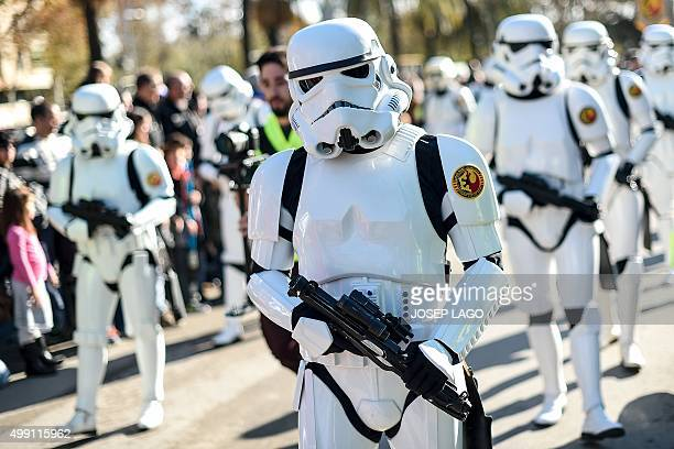 Participants dressed up as Imperial Soldiers of the Star Wars saga movie march during the 9th Star Wars parade in Barcelona on November 29 2015 / AFP...