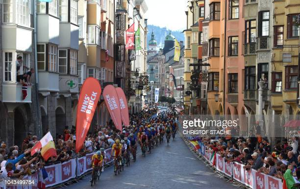 Participants drive through the old city of Innsbruck Austria during the Men's Elite road race of the 2018 UCI Road World Championships in Innsbruck...