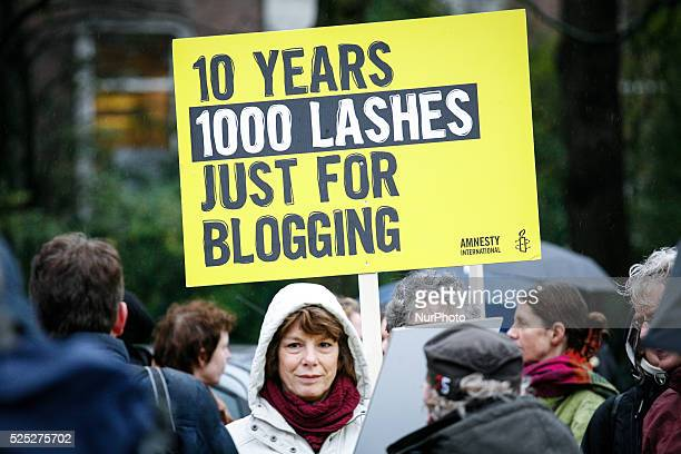 Participants during a protest organized by Amnesty International for the immediate release of the Saudi blogger Raif Badawi in front of the Saudi...