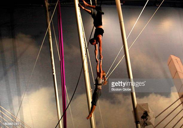 Participants during a trapeze class at TSNY Beantown in the Jordan's Furniture entertainment rotunda in Reading Mass on Wednesday Aug 19 2009 Blaize...