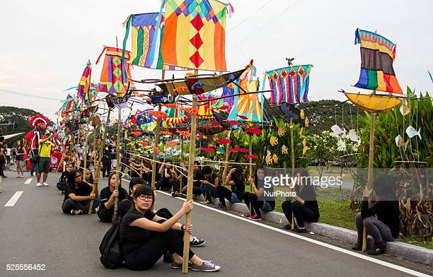 Participants during the UP annual lantern parade sitted on the assembly area in front the campus while waiting for the parade to start University of...