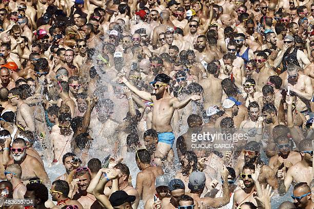 Participants enjoy in a swimming pool during the Circuit Festival's Water Park Day an open air gay party in Vilassar de Mar near Barcelona on August...