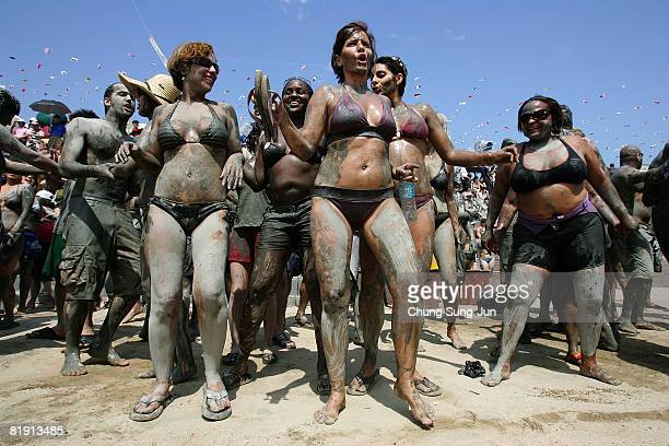 Participants enjoy mud during the Boryeong Mud Festival at Daecheon Beach on July 12 2008 in Boryeong City South Korea The annual mud festival now in...