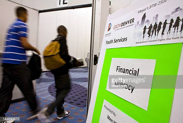 Participants enter a Financial Literacy training session at The Summer Youth Jobs Training Expo 2012 at the Colorado Convention Center in Denver...