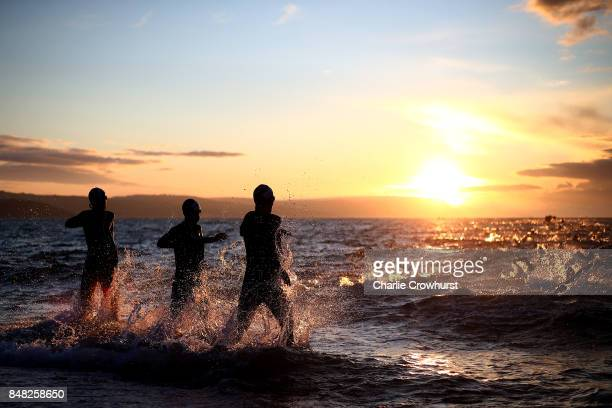 Participants enter the water as the look to start the swim leg of the race during IRONMAN 703 Weymouth on September 17 2017 in Weymouth England