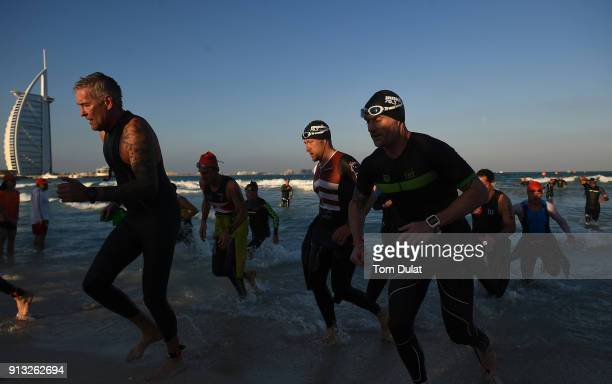 Participants exit the water during the Ironman 703 Dubai 2018 on February 2 2018 in Dubai United Arab Emirates