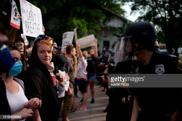 Participants face a row of police officers during a Justice for George Floyd event in Houston Texas on May 30 after George Floyd an unarmed black...