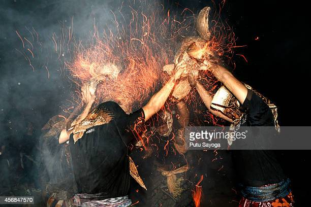 Participants fight during fire war ceremony at Dalem Temple on October 8 2014 in Tuban Kuta Indonesia The annual ceremony known locally as Siat Geni...
