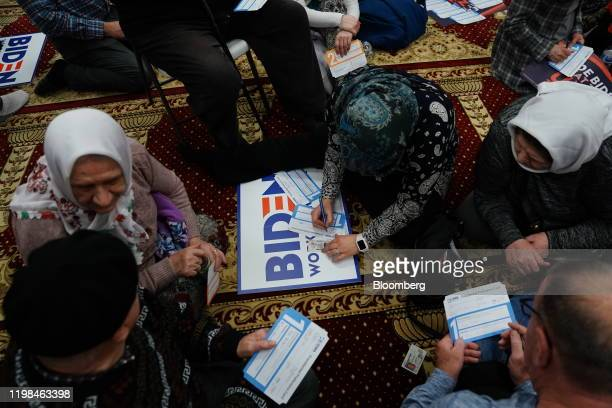 Participants fill out Presidential Preference Cards during the firstinthenation Iowa caucus at the Islamic and Education Center Ezan mosque in Des...