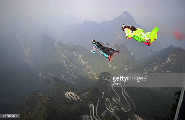 Participants fly in the sky with wingsuit during the final of 6day Wingsuit Flying World Championship sponsored by Red Bull on October 19 2014 in...