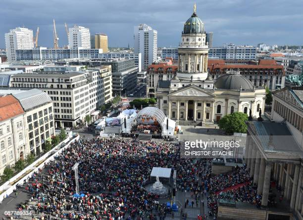 Participants follow the opening mass of the Kirchentag festival celebrating the 500th anniversary of the Reformation in Berlin Germany on May 24 2017...