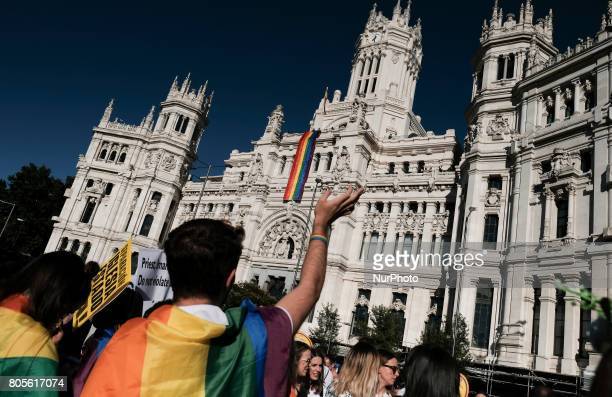 Participants gather at during the WorldPride 2017 parade in Madrid on July 1 2017 Revellers took to the rainbow streets of Madrid today in the...