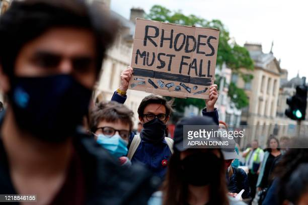 Participants gather during a protest called by the Rhodes Must Fall campaign calling for the removal of the statue of British imperialist Cecil John...
