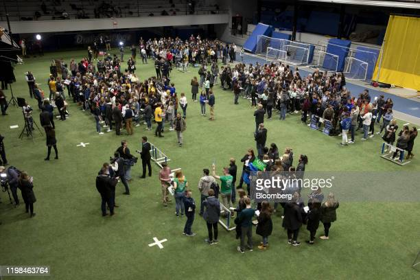Participants gather for their preferred democratic presidential candidate during the firstinthenation Iowa caucus at the Drake University Knapp...