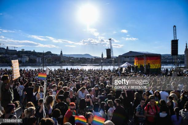 Participants gather near the parliament building in Budapest on June 14 during a demonstration against the Hungarian government's draft bill seeking...