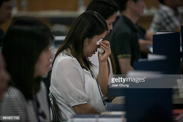 Participants get emotional during a Death Experience/Fake Funeral session held by Happy Dying led by Mr Kim Kiho who started this program since 2002...