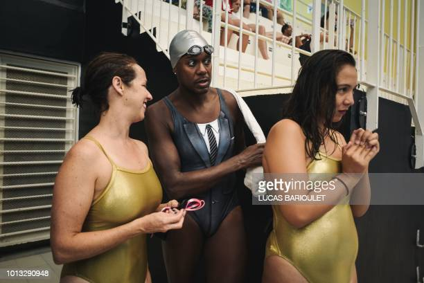 Participants get ready for the synchronized swimming contest during the 10th edition of the international Gay Games at the Maurice Thorez swimming...