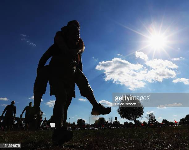 Participants go through the Wounded Warrior obstacle at the Tough Mudder event at Raceway Park on October 21 2012 in Englishtown New Jersey