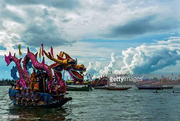 Participants handle a dragon boat during a dragon boat race on June 9 2016 in Danzhou Hainan Province of China More than one thousand people view the...
