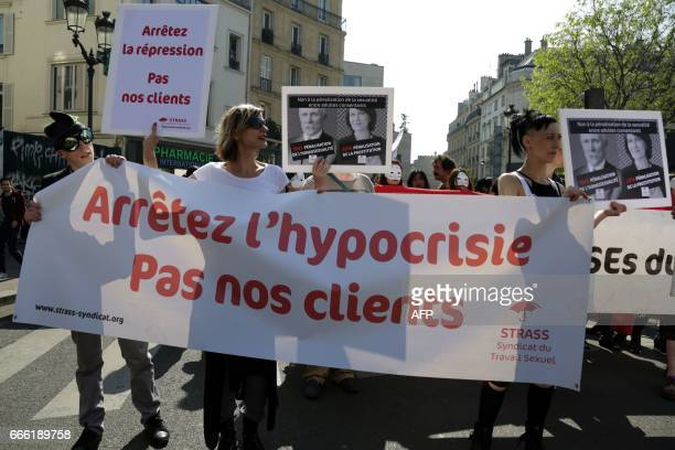 Participants hold a banner reading 'Stop the hypocrisy not our clients' during a demonstration for the rights of sex workers and prostitutes and...