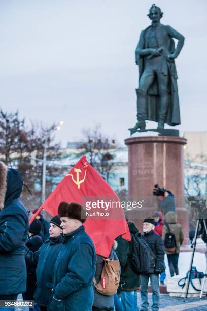Participants hold a soviet flag during a demonstration of members of the comunist party against the results of the russian elections 2018 in Moscow...