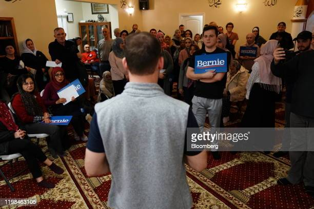 Participants hold campaign signs for Senator Bernie Sanders an Independent from Vermont and 2020 presidential candidate during the firstinthenation...