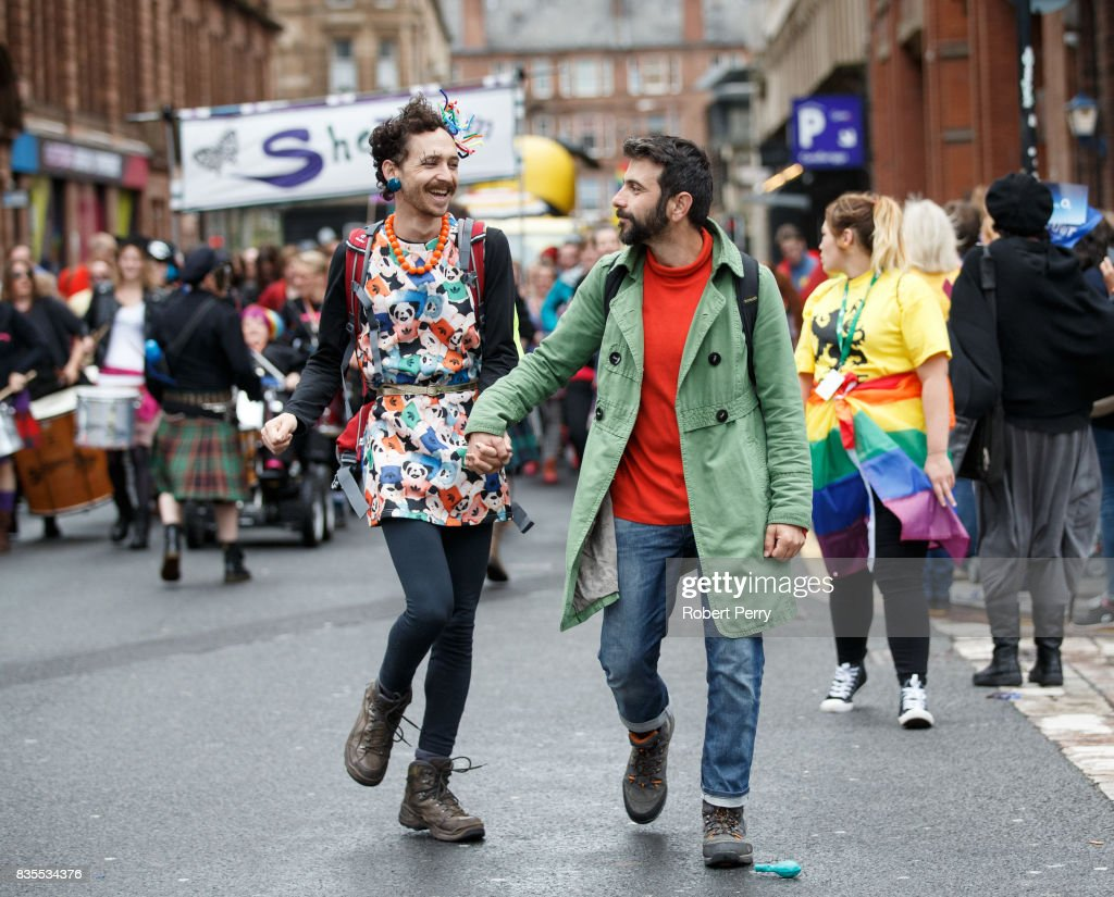 Participants hold hands during the Glasgow Pride march on August 19, 2017 in Glasgow, Scotland. The largest festival of LGBTI celebration in Scotland has been held every year in Glasgow since 1996.