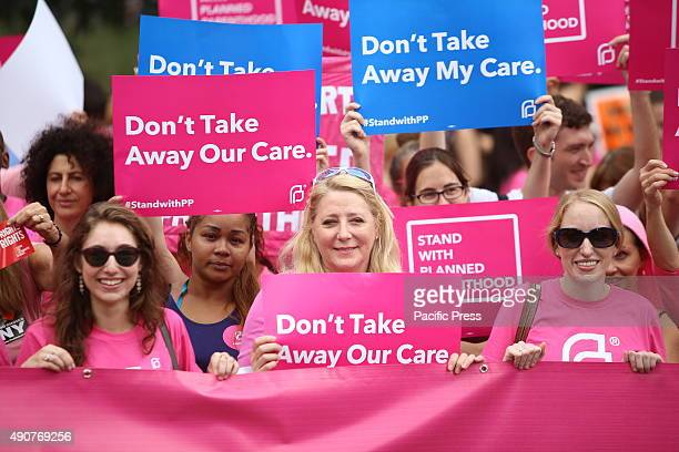 Participants hold pink Planned Parenthood banner and signs Activists and directors of Planned Parenthood NYC gathered in Foley Square along NYC first...