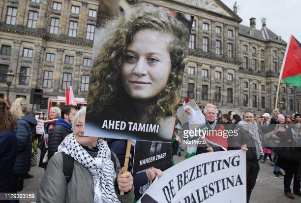 Participants hold placard In Support Of Ahed Tamimi as they take part in a quotWomen's Marchquot in Amsterdam on March 9 2019 one day after...