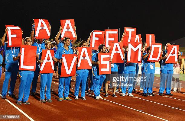 Participants hold signs aloft during the Closing Ceremony at the Apia Park Sports Complex on day five of the Samoa 2015 Commonwealth Youth Games on...