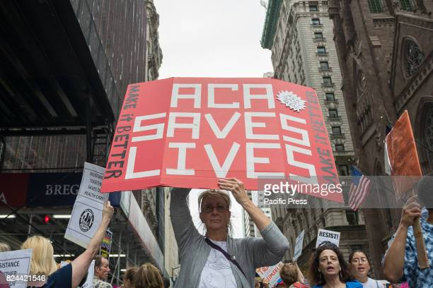 Participants hold signs while protesting the repeal and replacement of the Affordable Care Act. At back-to-back rallies in midtown Manhattan, liberal...