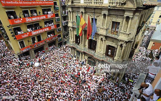 Participants hold up traditional red bandanas on July 6 2009 during the 'Chupinazo' in Pamplona to mark the start at noon sharp of the San Fermin...