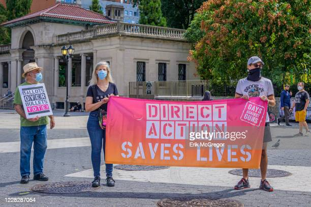 Participants holding a Direct Action Saves Lives banner. Gays Against Guns , the direct action, gun violence prevention group formed by members of...