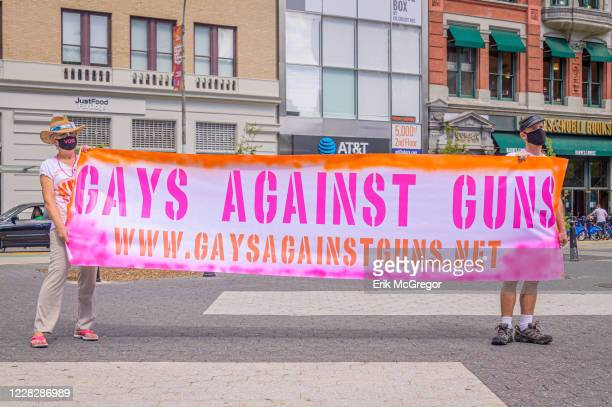 Participants holding a Gays Against Guns banner. Gays Against Guns , the direct action, gun violence prevention group formed by members of LGBTQ...