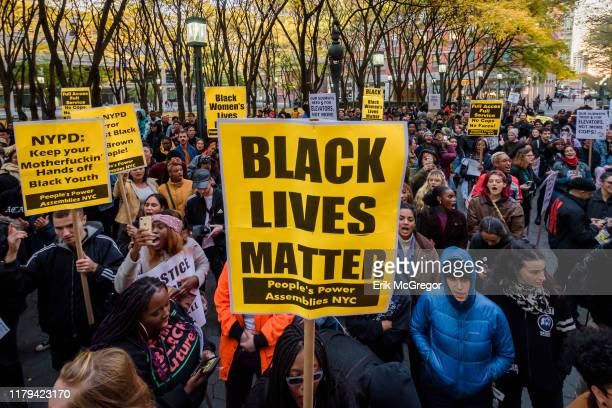 Participants holding BLACK LIVES MATTER protest signs at the rally in Metrotech Plaza Over a thousand people filled main avenues as they marched...