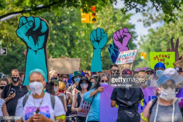 Participants holding Fist Up signs at the protest Thousands of New Yorkers joined the Coalition to Honor Black and Indigenous Activists at Fort...