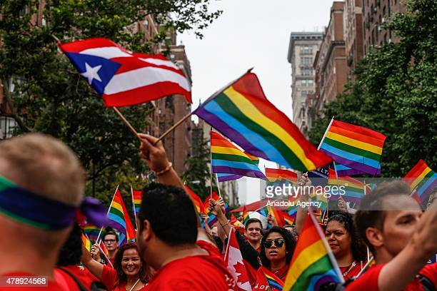 Participants holding flags march in the Gay Pride Parade on June 28, 2015 in New York City. The 22nd parade is held two days after the U.S. Supreme...