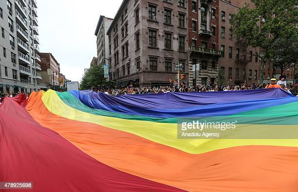 Participants holding flags march in the Gay Pride Parade on June 28 2015 in New York City The 22nd parade is held two days after the US Supreme...