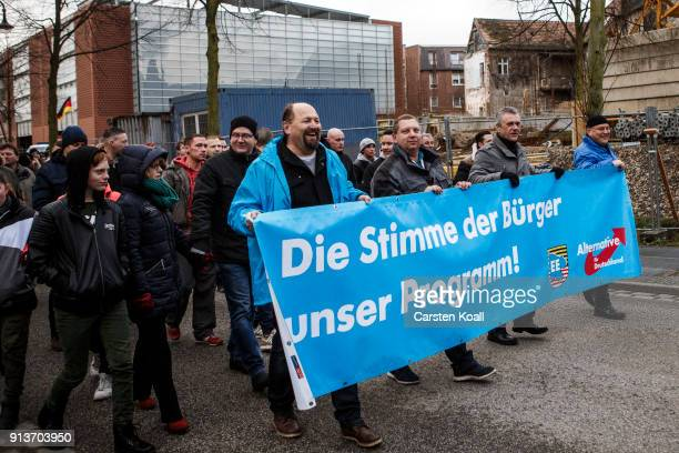 Participants holds a banner of the rightwing Alternative for Germany in an event organized by the rightwing group 'Zukunft Heimat' gather to protest...