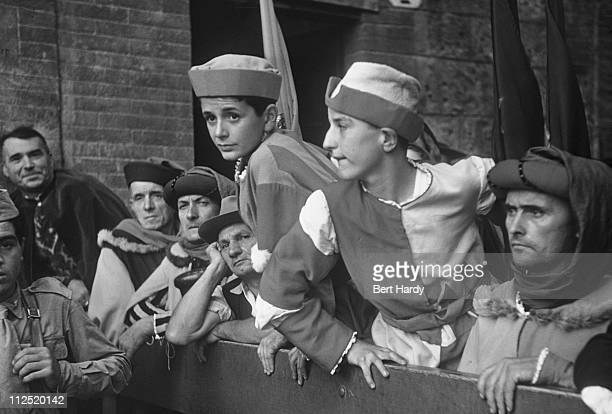 Participants in 15th Century clothing at the Palio di Siena, a traditional biannual horse race run in the Piazza del Campo, Siena, Italy, 1949....