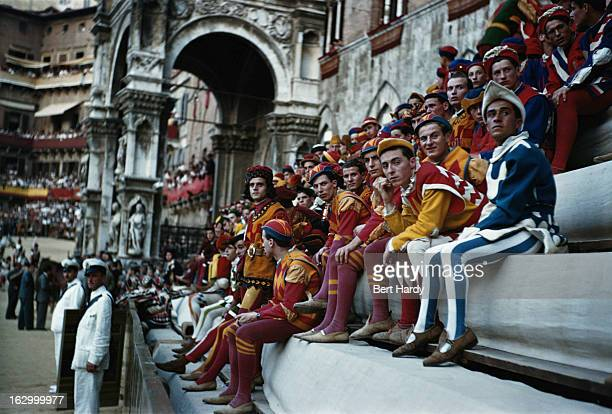 Participants in 15th Century clothing at the Palio di Siena a traditional biannual horse race run in the Piazza del Campo Siena Italy 1949 Picture...