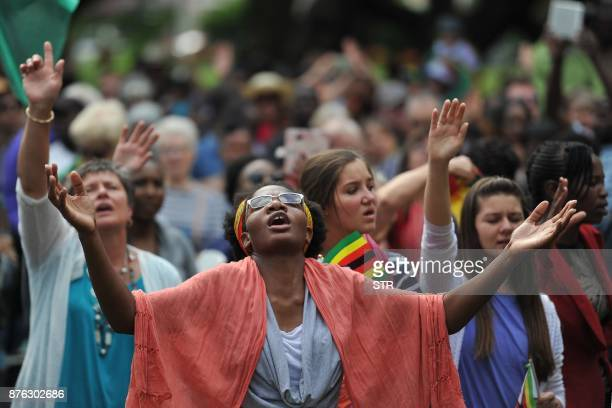 Participants in a religious gathering entitled 'Breakthrough prayer for Zimbabwe' hold their hands in the air as as they say prayers at Unity Square...