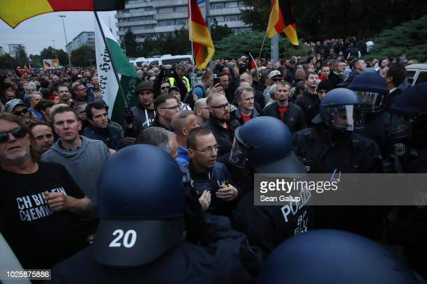 Participants in a right-wing march confront riot police after police halted the march due to a blockade by counter-demonstrators on September 1, 2018...