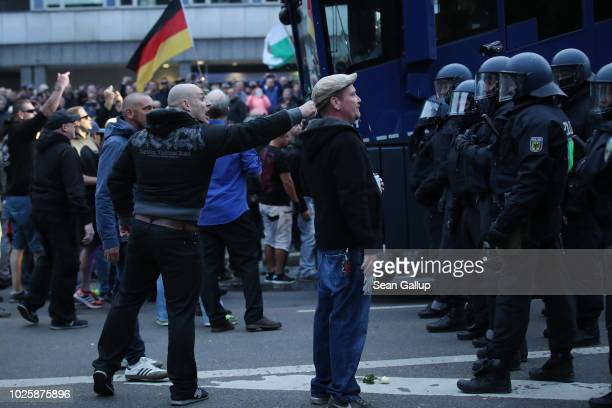 Participants in a rightwing march confront riot police after police halted the march due to a blockade by counterdemonstrators on September 1 2018 in...